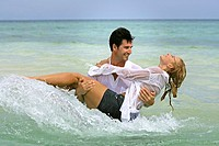 couple in love have a lot of fun at holiday on tropical beach in Thailand