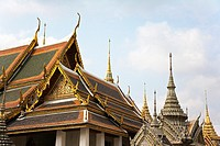 Traditional structures decorated in gold at the Grand Palace in Bangkok Thailand
