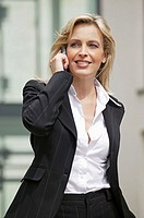 Business woman phoning on the street