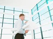 Architect reviewing blueprints