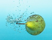 Close up of pear splashing in water