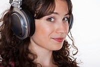 young woman listening to music in headphones