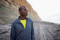 Black man standing on beach