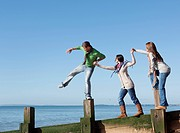 People balancing on jetty