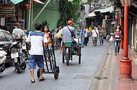 delivering goods in narrow streets of Chinatown, Bangkok, Thailand