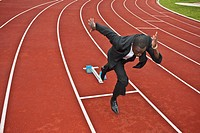 businessman sprinting on running track