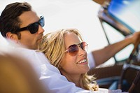Young couple, sunglasses, convertible, happy