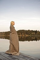 Young woman standing on jetty,enjoying