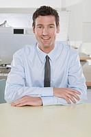 Germany, Munich, business man in office, smiling, portrait (thumbnail)