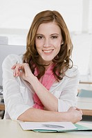 Germany, Munich, young woman in office, smiling, portrait