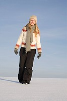 Germany, Bavaria, Munich, Young woman in snowy landscape