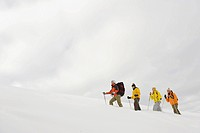 Italy, South Tyrol, People snowshoeing in a row