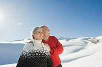 Italy, South Tyrol, Seiseralm, Senior couple in winterly landscape