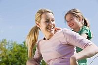 Germany, Bavaria, Munich, Mother and daughter 6_7, having fun, portrait