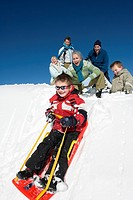 Italy, South Tyrol, Seiseralm, Family sledding
