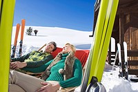 Italy, South Tyrol, Seiseralm, Couple resting in chairs