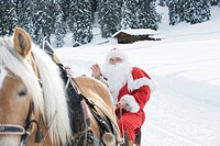 Italy, South Tyrol, Seiseralm, Santa Claus sitting in sleigh
