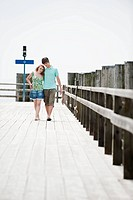Germany, Bavaria, Ammersee, Couple walking across pier