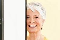 Senior woman smiling, portrait, close-up (thumbnail)