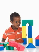 African boy 3-4 playing with building bricks, portrait (thumbnail)