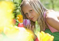 Austria, Salzkammergut, Girl 10_11 smelling flowers, side view, portrait