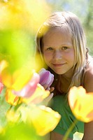 Austria, Salzkammergut, Portrait of a girl 10_11 in garden, portrait