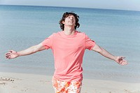 Spain, Mallorca, Man with arms outstretched at beach