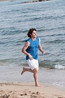 Spain, Mallorca, Man jogging on beach