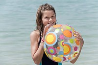 Spain, Mallorca, Girl 10_11 holding beach ball