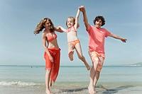 Spain, Mallorca, Family on beach, having fun