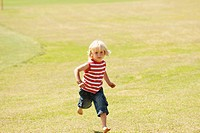 Spain, Mallorca, Boy 3_4 running across meadow