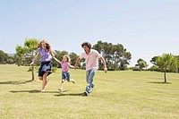 Spain, Mallorca, Family running across meadow
