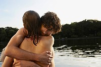 Germany, Berlin, Young couple embracing by Spree river, close_up