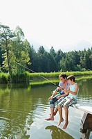 Italy, South Tyrol, Father and son 10_11 fishing