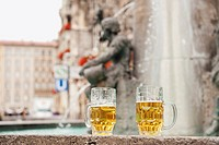 Germany, Bavaria, Munich, Marienplatz, Two beer mugs standing by fountain