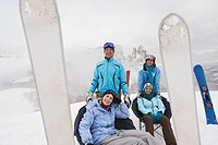 Italy, South Tyrol, Four people in winter clothes, taking a break