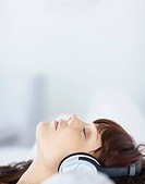 Woman listening to music over headphones