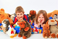 little boy and girl in bed with toy animals, studio, Oetwil am See, Zuerich, Switzerland