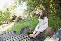 Girl sitting on rock