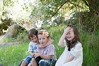 Boys and girl messing around outdoors