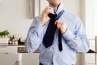 Man tying tie