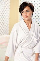 Young woman wearing bathrobe