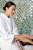 Woman having hand massage