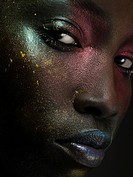Young woman with face covered in metallic make up (thumbnail)