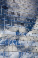 Reflection of sky in windows of office building