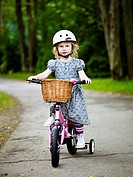 Scandinavia, Sweden, Stockholm, Girl riding bicycle