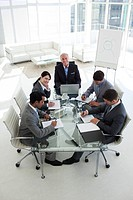 High angle of a business team sitting around a conference table in the office