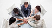 High angle of business people with hands together Concept of teamwork