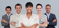 Smiling multi_ethnic young business team with folded arms