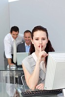 Charming businesswoman asking for silence in the office